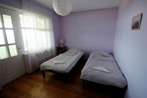 Кровать или кровати в номере Гостевой Дом Еловый Пик