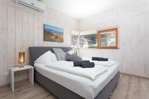 Ein Bett oder Betten in einem Zimmer der Unterkunft Designferienhaus Altenmarkt Zauchensee