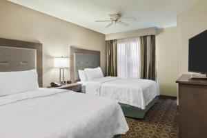 A bed or beds in a room at Homewood Suites Baton Rouge