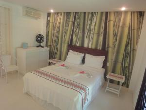 A bed or beds in a room at Maracajau - Luxury Beach Villa