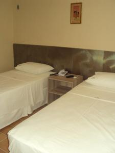 A bed or beds in a room at Angica Golden Hotel