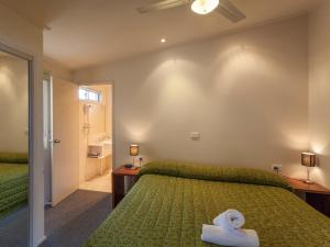 A bed or beds in a room at NRMA Eastern Beach Holiday Park