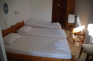 Ένα ή περισσότερα κρεβάτια σε δωμάτιο στο Hotel Marlton