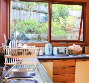 A kitchen or kitchenette at House in Epping