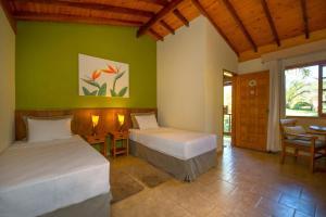 Cama ou camas em um quarto em Pousada Paiol
