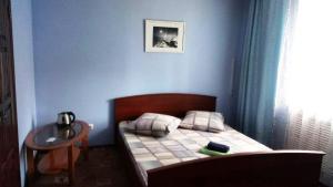 Кровать или кровати в номере Мини-гостиница Валенсия