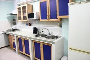 Кухня или мини-кухня в Мини-гостиница Валенсия