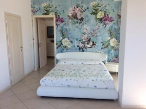 A bed or beds in a room at Appartamento Regina Margherita 171