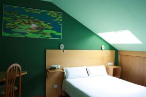 Cama o camas de una habitación en Xabu Hostel