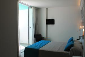 A bed or beds in a room at Apartamentos Bora Bora - Adults Only