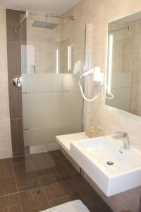 Ein Badezimmer in der Unterkunft Hotel Ganslhof
