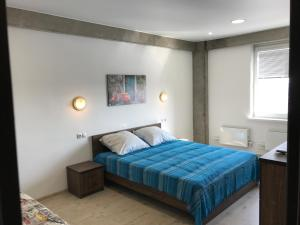 A bed or beds in a room at Apartaments Ivanovo-City on Kuznecova 67