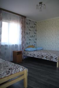 Кровать или кровати в номере Guest House Elena