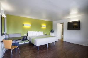 A bed or beds in a room at Motel 6 - Downtown Monterey
