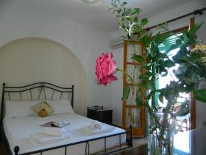 A bed or beds in a room at Ioanna Apartments