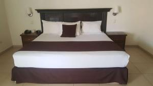 A bed or beds in a room at Hotel Go Inn