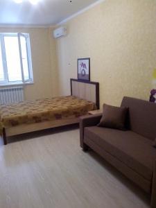 Кровать или кровати в номере Apartment on Lenina 136
