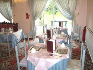 A restaurant or other place to eat at Alpha Milton Guest House