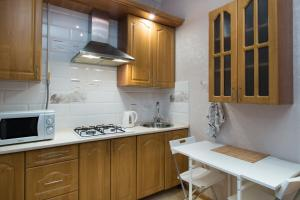 A kitchen or kitchenette at Автозаводская Флэтио