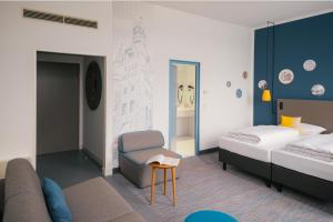 A bed or beds in a room at Vienna House Easy Wuppertal