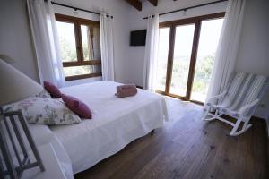 Cama o camas de una habitación en Bou Ros Finca Es Foners