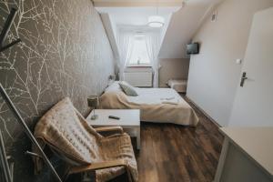 Łóżko lub łóżka w pokoju w obiekcie Gosciniec Zacisze