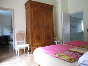 Un ou plusieurs lits dans un hébergement de l'établissement Chambres d'Hotes Spa Château d'Omiécourt