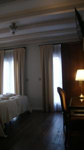 Cama o camas de una habitación en LANTIGUA CASA RURAL