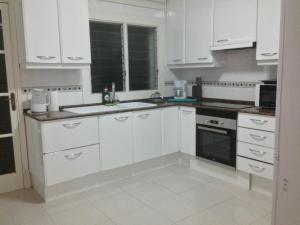 A kitchen or kitchenette at Playa de Palma Beach House