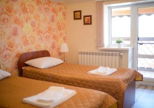 Кровать или кровати в номере Мотель Вояж