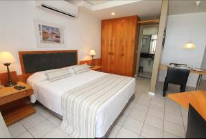 A bed or beds in a room at Room Office & Beach Apartments - Go Make A Trip