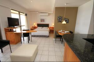 A television and/or entertainment centre at Room Office & Beach Apartments - Go Make A Trip