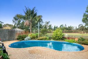 The swimming pool at or near Coranda Lodge