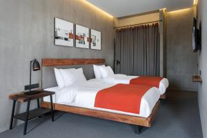A bed or beds in a room at IOTA Hotel Tbilisi