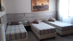 Letto o letti in una camera di Hotel Citta'