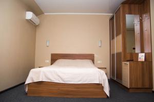 Кровать или кровати в номере Южный Дворик