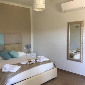 A bed or beds in a room at Il giardino di Daniela