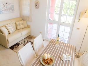 Area soggiorno di Gelso Bianco Apartments
