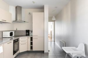 A kitchen or kitchenette at Sweet Apartment