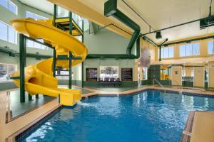 The swimming pool at or near Super 8 by Wyndham Calgary Shawnessy Area