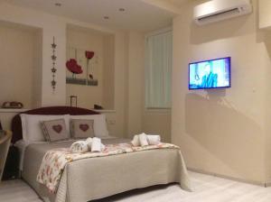 Una televisión o centro de entretenimiento en Casabruni