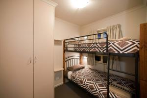 A bunk bed or bunk beds in a room at Leisure Ville Holiday Centre
