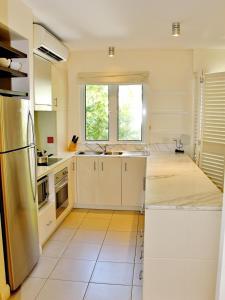 A kitchen or kitchenette at 6421 BEACH CLUB