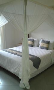 A bed or beds in a room at Paper Lotus Villa