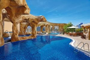 The swimming pool at or near Hilton Beirut Habtoor Grand Hotel