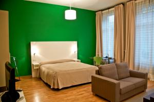 A bed or beds in a room at MAS Aparthotel EU