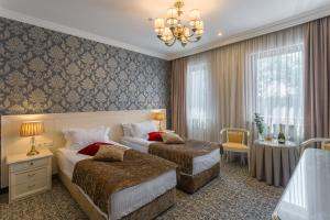 A bed or beds in a room at De Volan Boutique Hotel