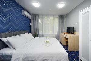 Кровать или кровати в номере Отель Апельсин на Юго-Западной