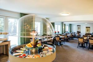 A restaurant or other place to eat at Hotel Astoria Bonn