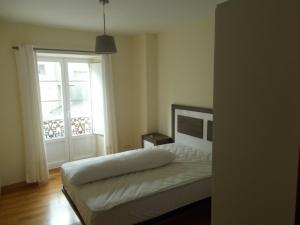 Cama o camas de una habitación en Apartamento Ría de Ribadeo